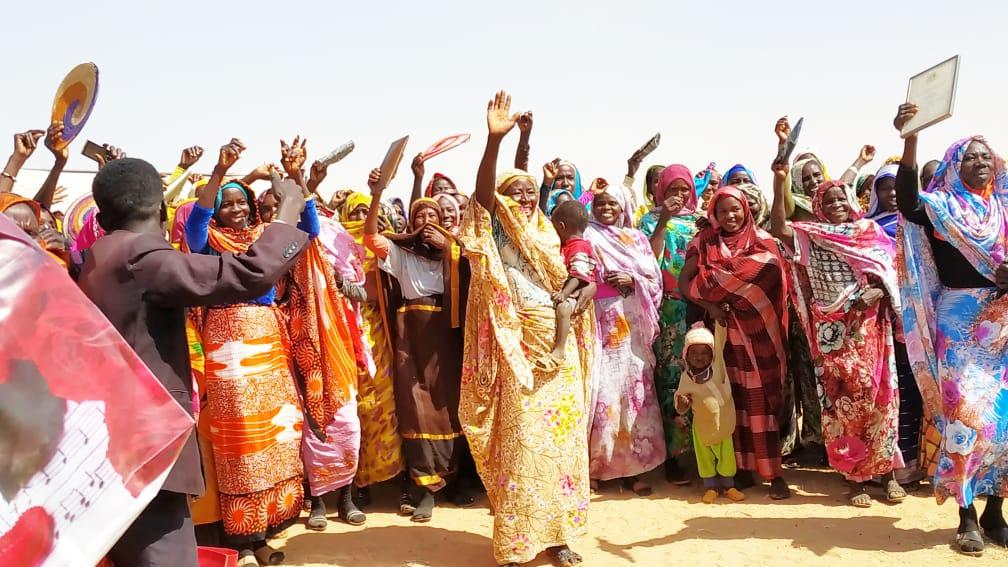 Women Waving Welcome